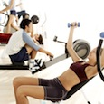 People Exercising at a Gymnasium --- Image by © Royalty-Free/Corbis